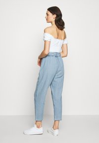 American Eagle - BUTTON FRONT PAPERBAG TAPER PANTS - Trousers - light blue - 2