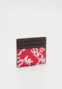 Michael Kors - TALL CARD CASE UNISEX - Wallet - red/black - 1