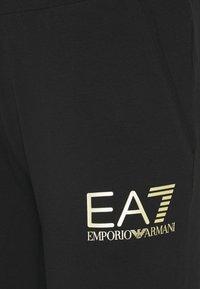 EA7 Emporio Armani - Tracksuit bottoms - black - 5