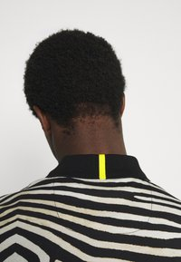 Lacoste - LACOSTE X NATIONAL GEOGRAPHIC - Polo shirt - black/white - 4