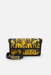 Versace Jeans Couture - LULA BAGUETTE - Handbag - black/dark yellow - 1