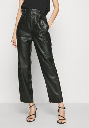 NIKA - Pantaloni - black