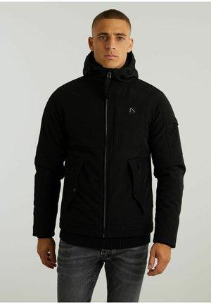 RETURN SOFTSHELL - Light jacket - black