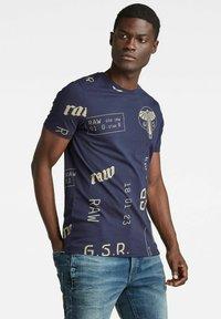 G-Star - GRAPHICS ALLOVER SLIM - Print T-shirt - warm sartho extreme - 3