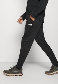 The North Face - MENS SURGENT CUFFED PANT - Tracksuit bottoms - black