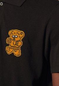 sandro - TEDDY - Polo shirt - noir - 4