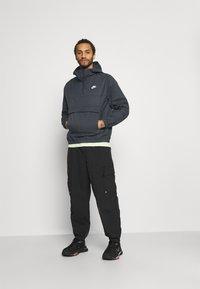 Nike Sportswear - ANORAK  - Windbreaker - black - 1