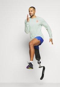 Nike Performance - DRY TEE TRAIL - Camiseta de deporte - pistachio frost - 1