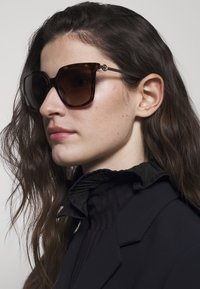 Tory Burch - Sunglasses - mottled brown - 1
