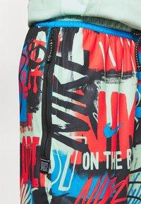Nike Performance - DNA SHORT CITY EXPLORATION SERIES - Pantaloncini sportivi - enamel green - 4