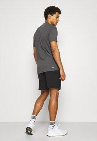 adidas Performance - Korte sportsbukser - black/white - 2