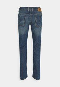 Diesel - THOMMER-X - Slim fit jeans - medium blue - 6