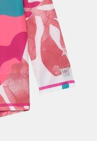 Reima - TUVALU UNISEX - Rash vest - fuchsia pink - 2