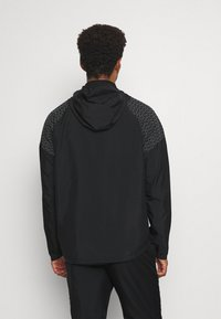 Nike Performance - NIKE RUN DIVISION FLASH - Sports jacket - black/silver