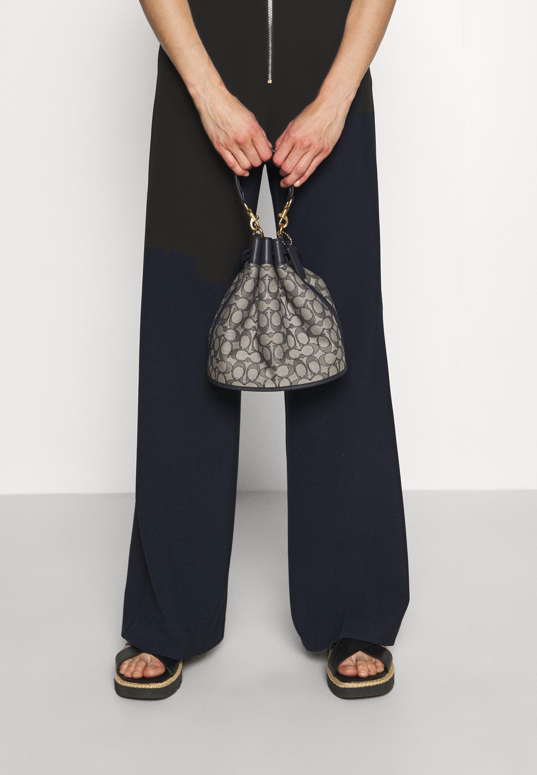 Women SIGNATURE FIELD BUCKET BAG - Across body bag