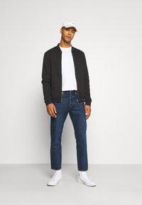 ARKET - Slim fit jeans - blue dark - 1