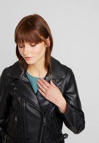Vero Moda - VMCOOL SHORT COATED JACKET - Faux leather jacket - black - 3