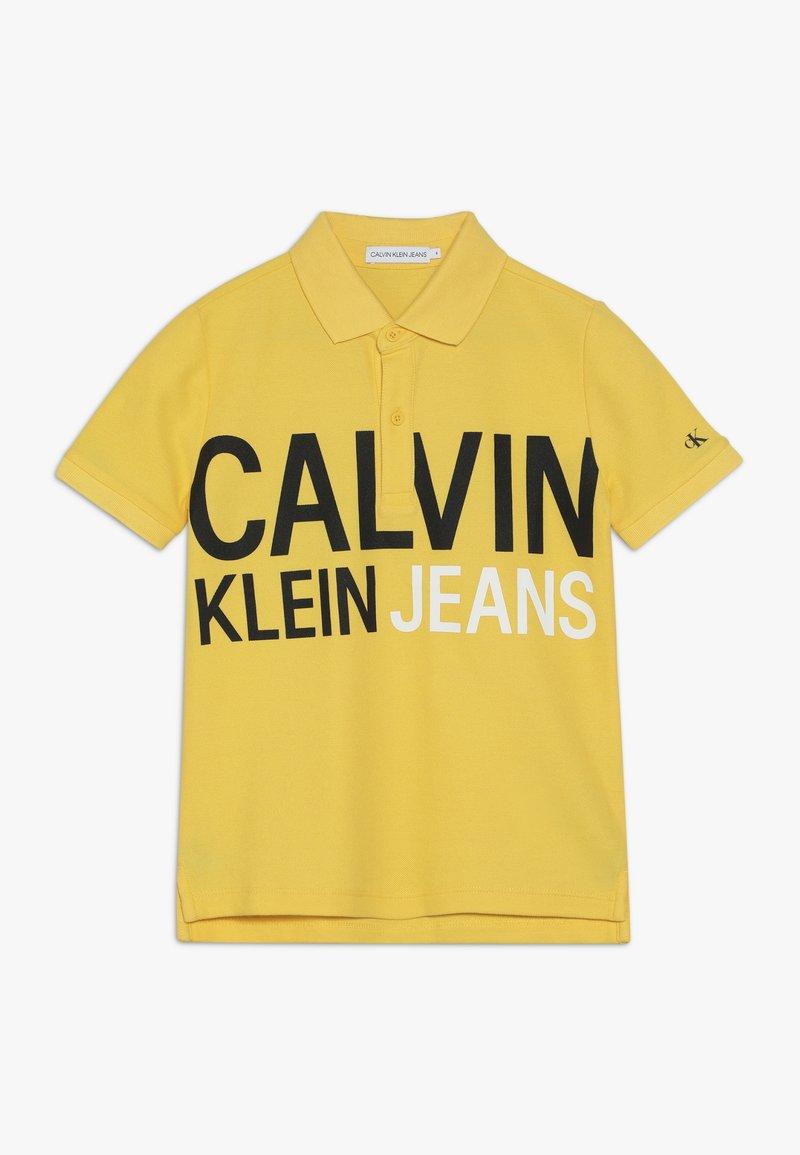 Calvin Klein Jeans - STAMP LOGO  - Polo shirt - yellow