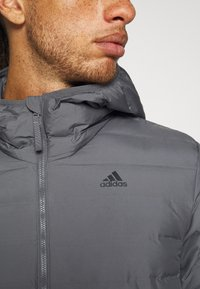 adidas Performance - VARILITE SOFT HOODED - Down jacket - dark grey - 4