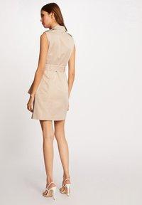 Morgan - BUTTONED SLEEVELESS WRAP  - Shirt dress - beige - 2