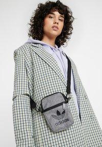 adidas Originals - MEL FEST BAG - Across body bag - black/white - 5