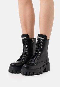 Patrizia Pepe - Lace-up ankle boots - nero - 0