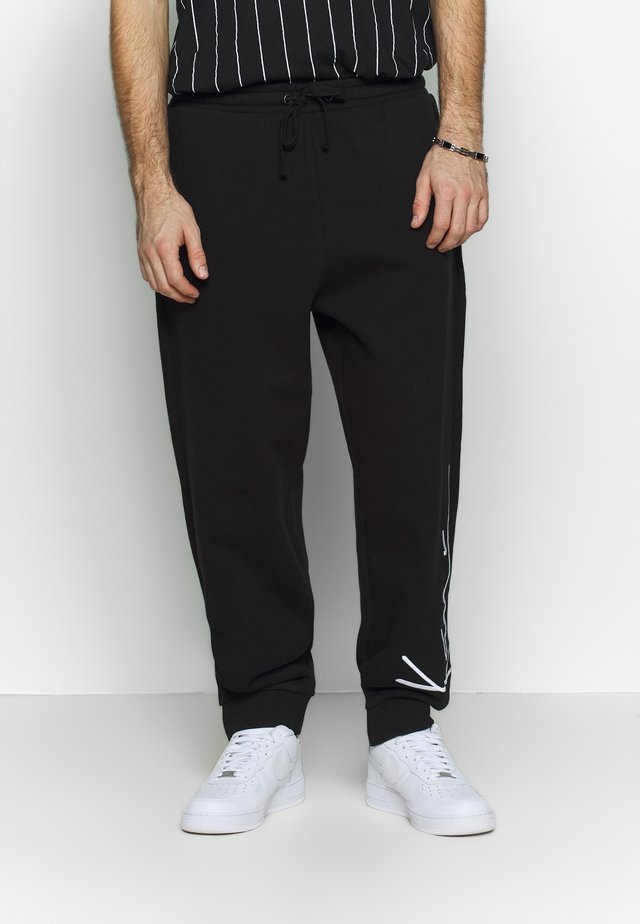 SIGNATURE RETRO - Tracksuit bottoms - black/white
