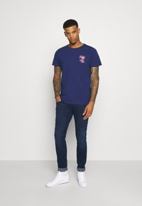 Replay - ANBASS X LIGHT - Slim fit jeans - dark blue - 1
