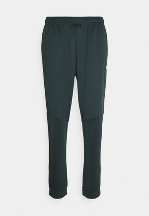 HERREN FUAT - Tracksuit bottoms - green