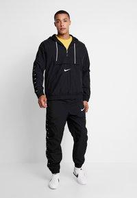Nike Sportswear - PANT - Pantalones deportivos - black/white - 1