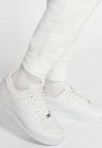 Nike Sportswear - CLUB - Tracksuit bottoms - white/white/black - 6