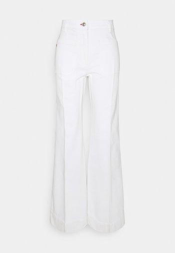 ALINA - Flared Jeans - white