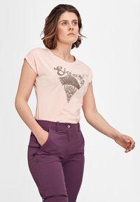 Mammut - RUNBOLD ZIP OFF WOMEN - Outdoor trousers - blackberry - 4