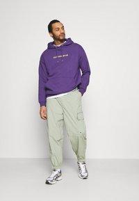 YOURTURN - UNISEX - Jersey con capucha - purple - 1