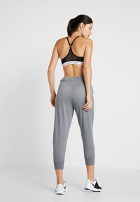 Nike Performance - DRY GET FIT - Tracksuit bottoms - carbon heather/black - 2