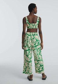 OYSHO - TROPICAL - Trousers - green - 2