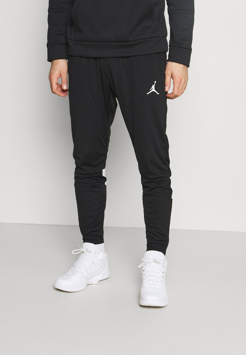 Jordan - AIR PANT - Verryttelyhousut - black/white