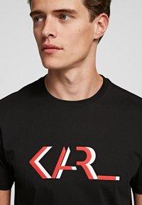 KARL LAGERFELD - LEGEND - Print T-shirt - black - 2