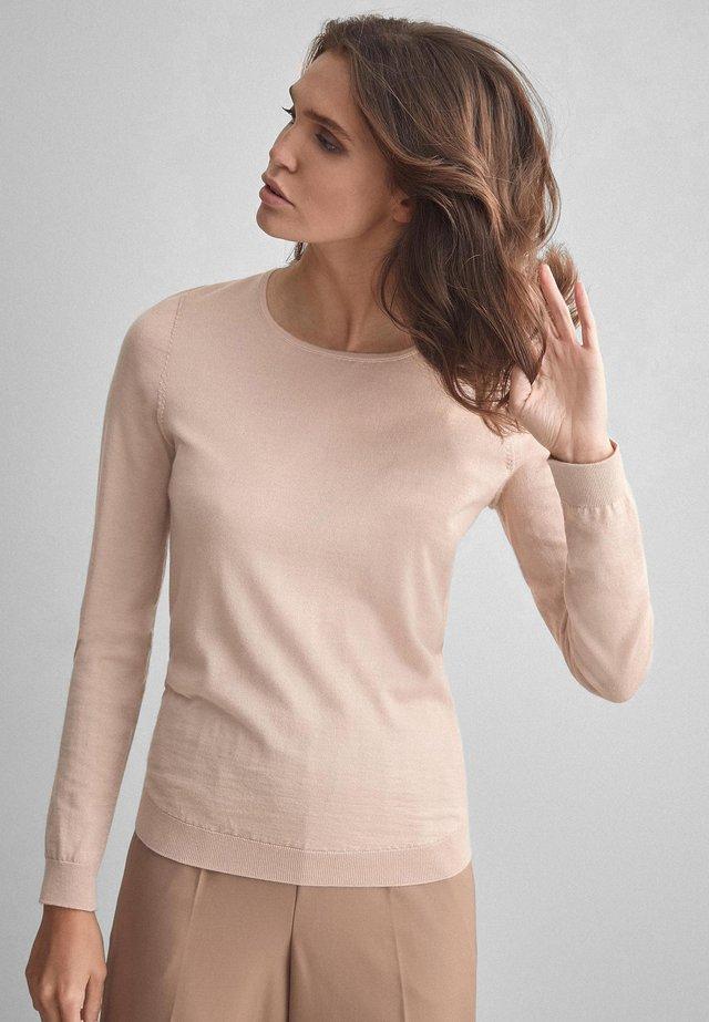 Stickad tröja - rosa cipria