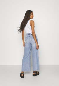 Tommy Jeans - ULTRA WIDE LEG - Relaxed fit jeans - light blue denim - 2