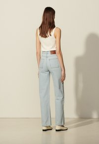 sandro - Relaxed fit jeans - bleached denim