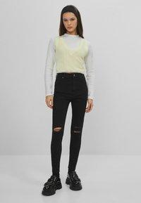 Bershka - SUPER HIGH WAIST - Jeans Skinny Fit - black - 1