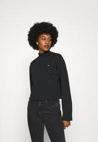Tommy Jeans - SOLID HYBRID LONGSLEEVE - Bluzka z długim rękawem - black - 0