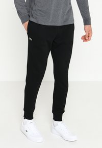 Lacoste Sport - CLASSIC PANT - Träningsbyxor - black - 0