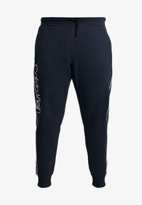 Calvin Klein - LOGO PRINT PANT - Träningsbyxor - blue - 3