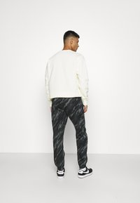 Nike Sportswear - PANT - Tracksuit bottoms - black/orange - 2