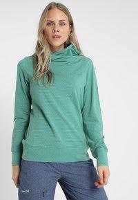 Vaude - WOMENS TUENNO PULLOVER - Long sleeved top - nickel green - 0
