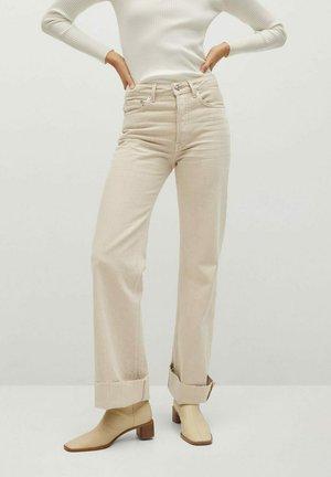 ARIADNA - Bootcut jeans - open beige