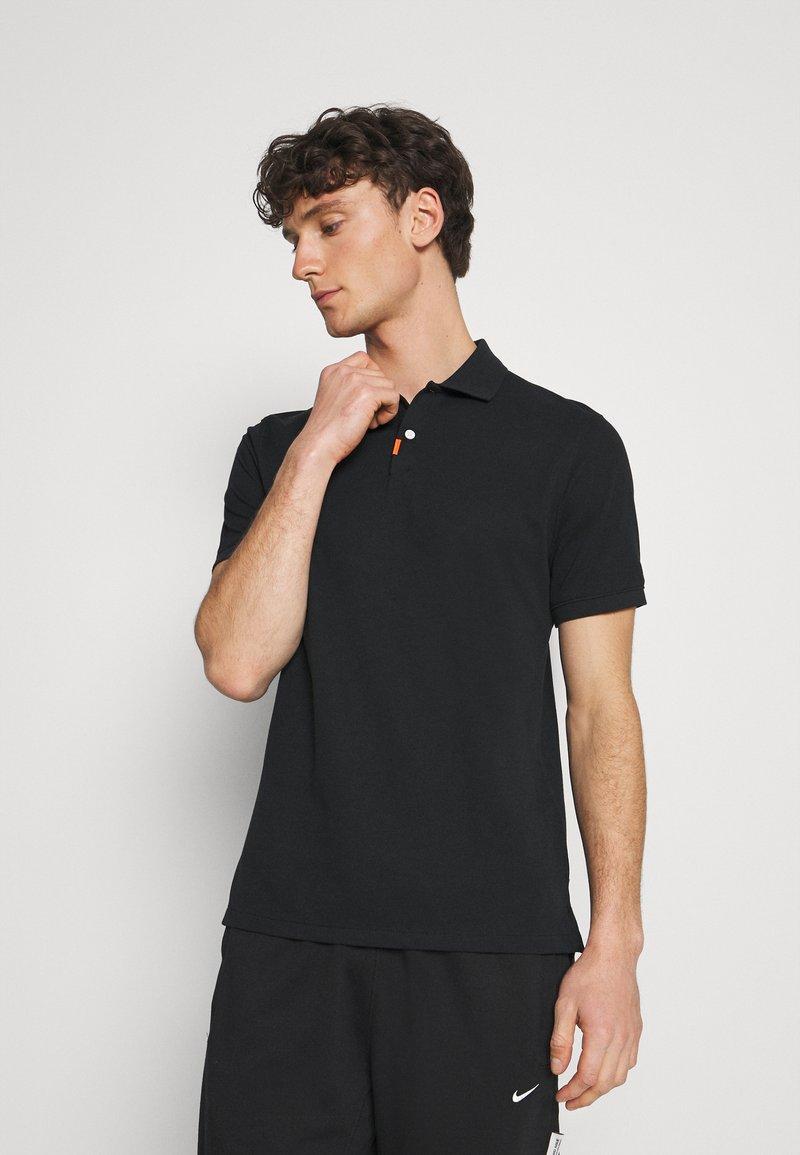 Nike Sportswear - THE SLIM  - Polo shirt - black