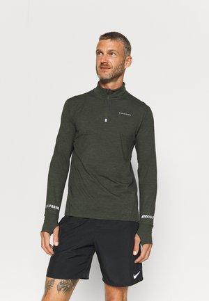 TUNE  - Sports shirt - rosin
